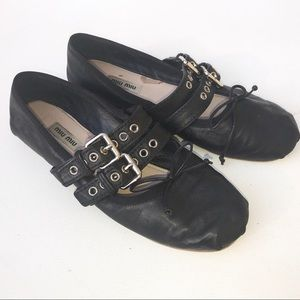 MIU MIU black flats leather 38 1/2 8 1/2 grommet